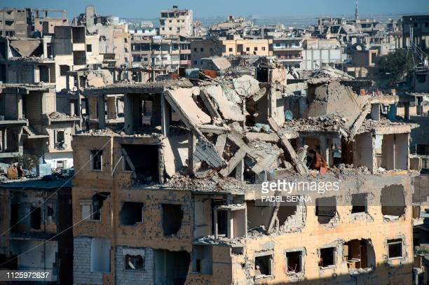 TOPSHOT Destroyed buildings are pictured in the Islamic State group's former Syrian capital of Raqa in northern Syria on February 19 2019 The...