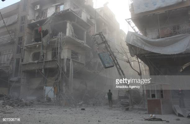 Destroyed buildings are seen after Assad Regime's airstrike hit residential areas in Eastern Ghouta's Douma town despite decisions to implement a...