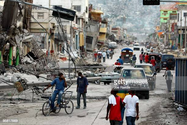 Destroyed buildings are seen after the massive earthquake January 16 2010 in PortauPrince Haiti Planeloads of rescuers and relief supplies headed to...
