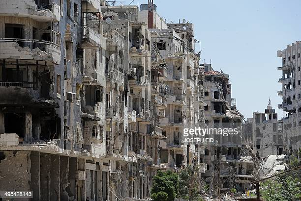 Destroyed buildings are seen in the Homs neighbourhood of Khaldiyeh formerly held by rebel fighters and captured by Syrian government forces in...
