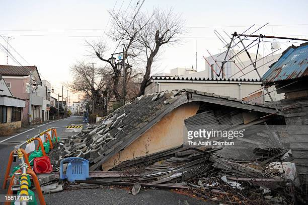 Destroyed buildings remain untouched after the Great East Japan Earthquake and the following tsunami hitting Okuma City, where the crippled Fukushima...