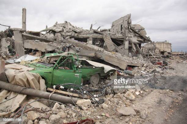 A destroyed car beneath the rubble of a house in Kobane Syria 30 January 2015 The Kurds have recaptured the city though the price is very high The...