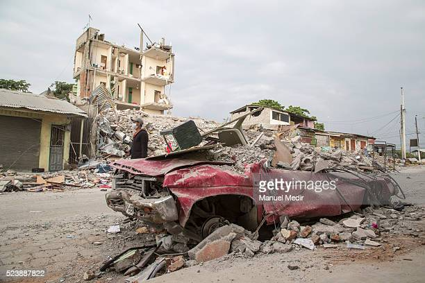A destroyed car is seen after an earthquake struck Ecuador on April 22 2016 in Portoviejo Ecuador At least 400 people were killed after a 78magnitude...