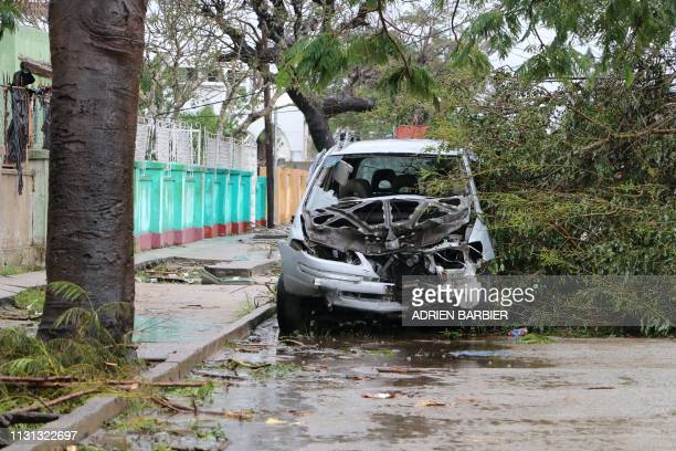 A destroyed car is seen amid the destruction provoked by the passage of the cyclone Idai in Beira Mozambique on March 17 2019 More than 120 people...
