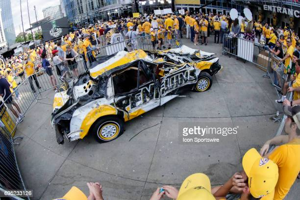 Destroyed car with Penguins logo with Predator fans prior to game 6 of the 2017 NHL Stanley Cup Finals between the Pittsburgh Penguins and Nashville...