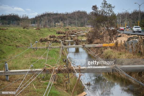 Destroyed electrical posts by Hurricane Maria is seen in Vega Alta Puerto Rico on September 30 2017 US military and emergency relief teams ramped up...