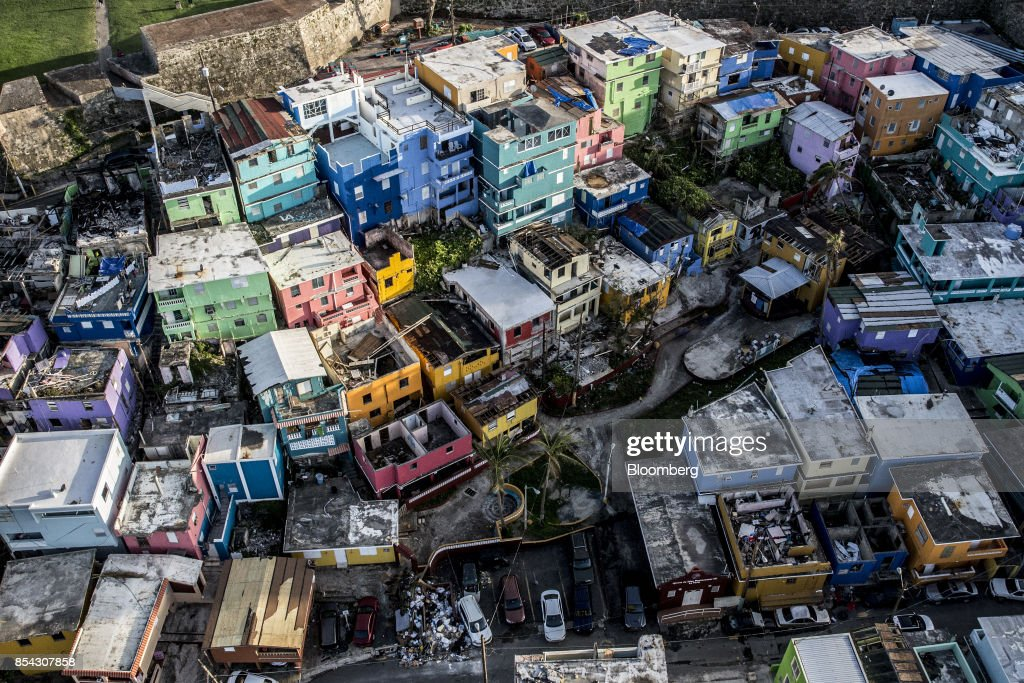 Destroyed homes sit surrounded by debris from Hurricane Maria in this aerial photograph taken above La Perla in San Juan, Puerto Rico, on Monday, Sept. 25, 2017. Hurricane Maria hit the Caribbean island last week, knocking out electricity throughout the island. The territory is facing weeks, if not months, without service as utility workers repair power plants and lines that were already falling apart. Photographer: Alex Wroblewski/Bloomberg via Getty Images