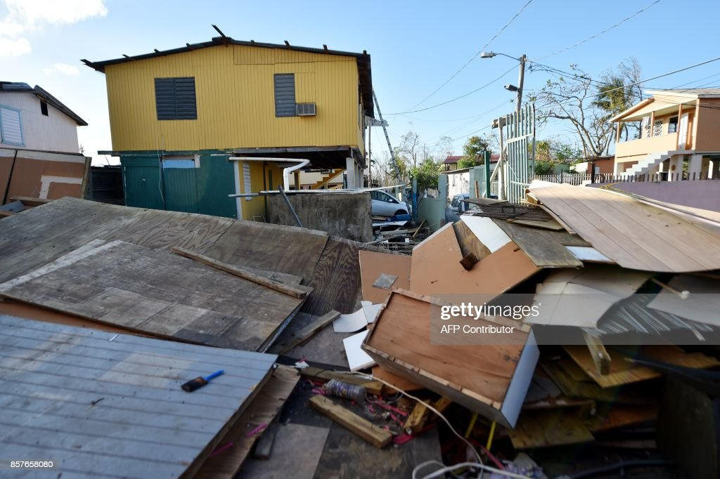 A destroyed house is seen in Juana Matos, Catano, Puerto Rico, on October 4, 2017, two weeks after the passage of the Hurricane Maria US President Donald Trump on asked Congress for a bumper $29 billion package of emergency relief after Hurricane Maria slammed into Puerto Rico. /