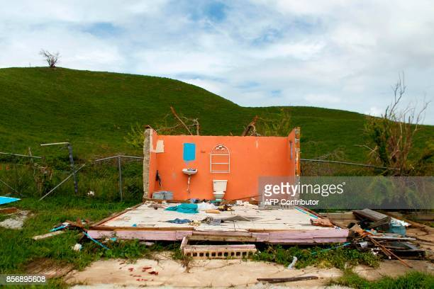 TOPSHOT A destroyed house is seen in the aftermath of Hurricane Maria in Naguabo Puerto Rico on October 2 2017 President Donald Trump strenuously...