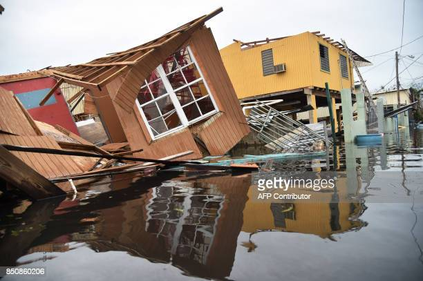 A destroyed house lays flooded in Catano town in Juana Matos Puerto Rico on September 21 2017 Puerto Rico braced for potentially calamitous flash...