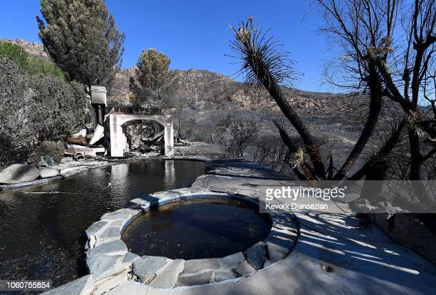 A destroyed house with its pool full of debris is seen on November 12 2018 in Thousand Oaks California as the Woolsey Fire continues to burn Multiple...