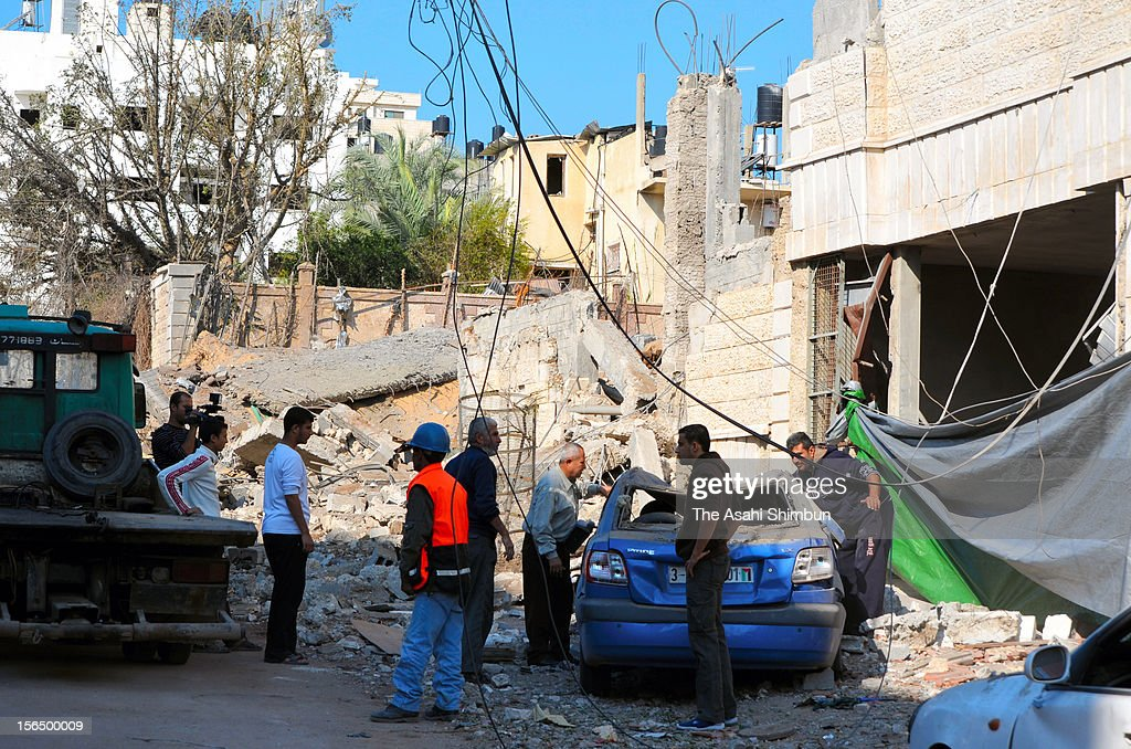 Destroyed houses and cars are seen on November 15, 2012 in Gaza City, Gaza. The IDF targeted nearly 200 sites in the Gaza Strip, killing Ahmed Jabari, a top military commander of Hamas.