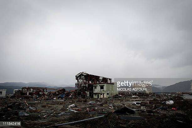 Destroyed houses and debris lay on the ground of the tsunamidamaged city of Rikuzentakata in Iwate prefecture on March 22 2011 The twin quake and...