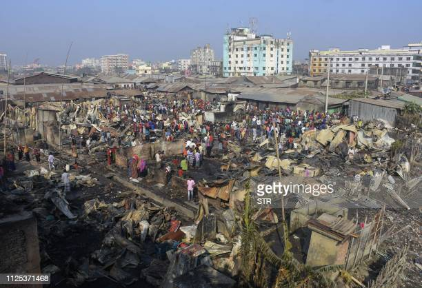 Destroyed houses are pictured after a fire broke out in a slum in Chittagong on February 17 2019 A fire tore through a slum in southern Bangladesh on...