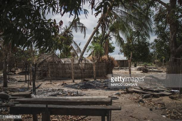 Destroyed houses are seen in the recently attacked village of Aldeia da Paz outside Macomia, on August 24, 2019. - On August 1st, the inhabitants of...