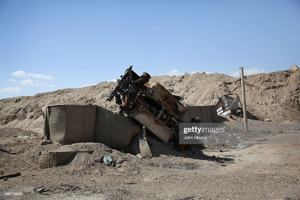 A destroyed Iraqi Army vehicle lies blown atop a defensive position near the frontline with ISIL fighters on April 14, 2015 near Al-Karmah, in Anbar Province, Iraq. Iraqi government forces are assaulting ISIL positions which were established last year when ISIL captured much of the province.