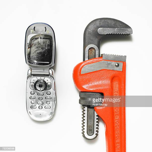 Destroyed mobile phone and wrench