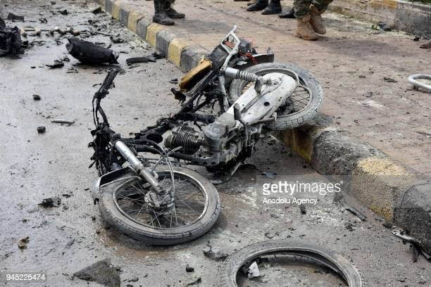 A destroyed motorbike is seen on the ground at the site after a bomb laden vehicle exploded near the local council building in the opposition...
