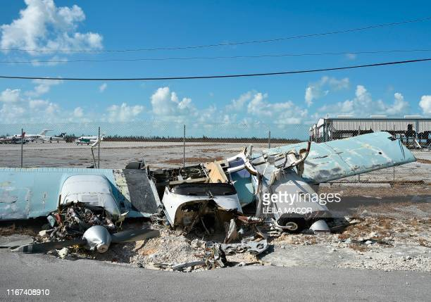 TOPSHOT A destroyed plane is seen at the airport at Freeport on Grand Bahama island on September 10 2019 Some 2500 people are unaccounted for in the...