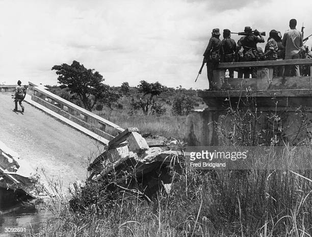 A destroyed road bridge on the Luchis river blown up by UNITA to hold back the advancing forces of the Cubanled MPLA during the civil war in Angola