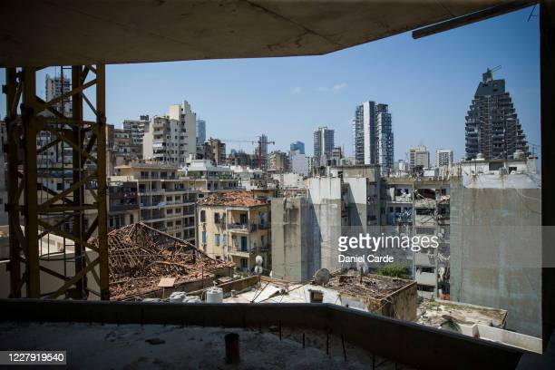 Destroyed rooftops and facades are visible from a high-rise building a day after a massive explosion occurred at the port on Aug. 5, 2020 in Beirut,...
