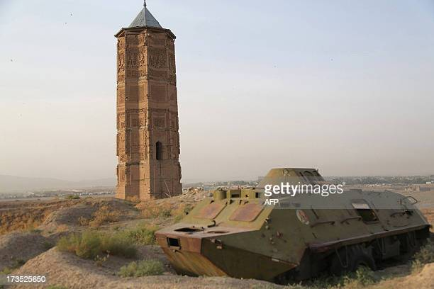 A destroyed Russian tank is seen alongside one of two minarets built in the 12th century in Ghazni city on July 16 2013 Ghazni has been chosen by the...