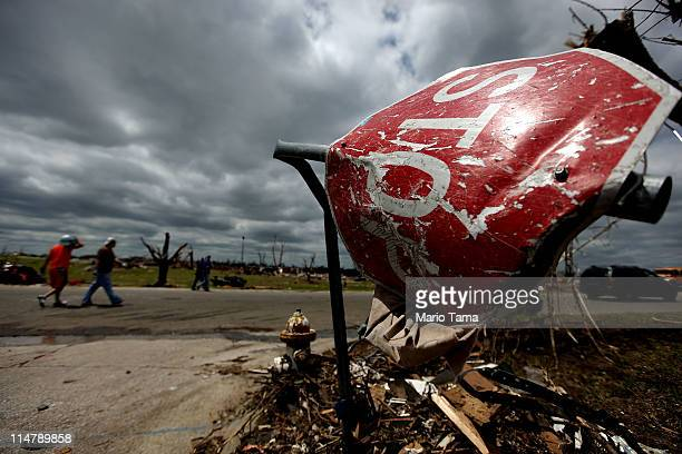 Destroyed stop sign is seen after a massive tornado passed through the town killing at least 125 people on May 26, 2011 in Joplin, Missouri. The town...