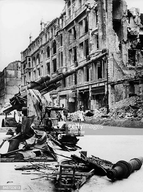 Destroyed street in Berlin in the foreground a wrecked antiaircraft gun