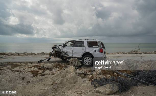 A destroyed SUV sits outside the Bahia Honda State Park on September 16 2017 in Marathon Florida Many places in the Keys still lack water electricity...