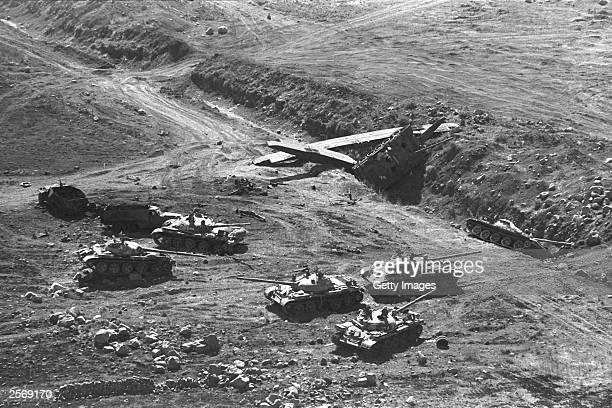 Destroyed Syrian T62 tanks and engineering equipment lies abandoned by retreating Syrian troops October 13 1973 on the Golan Heights a week into the...