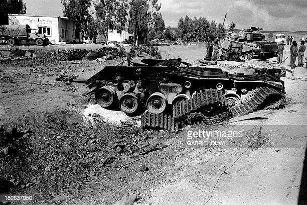 A destroyed Syrian tank is abandoned in a village on the Golan Heights in October 1973 two weeks after the beginning of the Yom Kippur War On October...