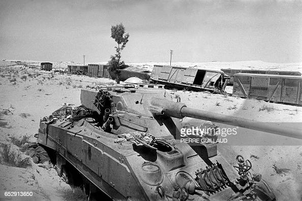 Destroyed tank and train are seen on the road in the Sinai ...