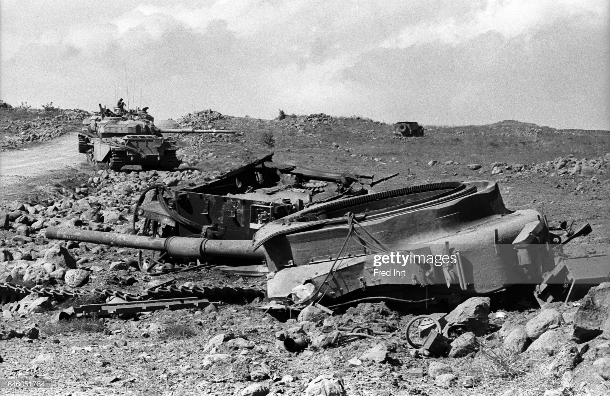 https://media.gettyimages.com/photos/destroyed-tank-in-the-foreground-soldiers-in-working-tanks-in-the-picture-id846051784?s=2048x2048