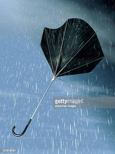 Destroyed umbrella flying away in the storm