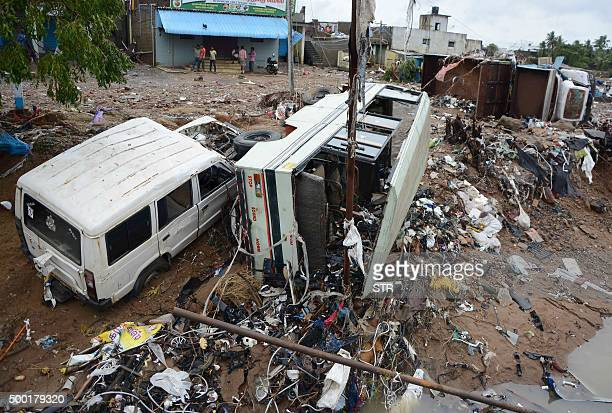 Destroyed vechiles are seen as floodwaters recede in Chennai on December 6 2015 Residents in India's southern Tamil Nadu state were grappling with...