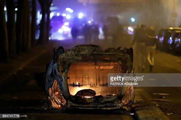 A destroyed vehicle burns during a protest in Bobigny a district of northeast Paris to denounce police brutality after a black man was allegedly...