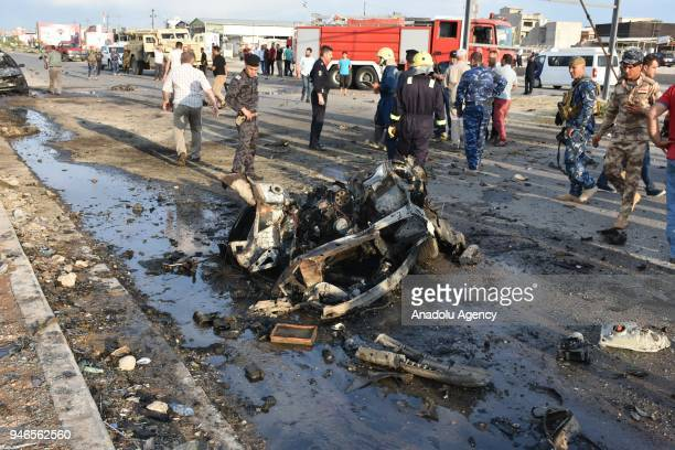 A destroyed vehicle is seen after an explosion carried out with a bombladen vehicle to assassinate a parliamentary candidate for the Turkmen Front...