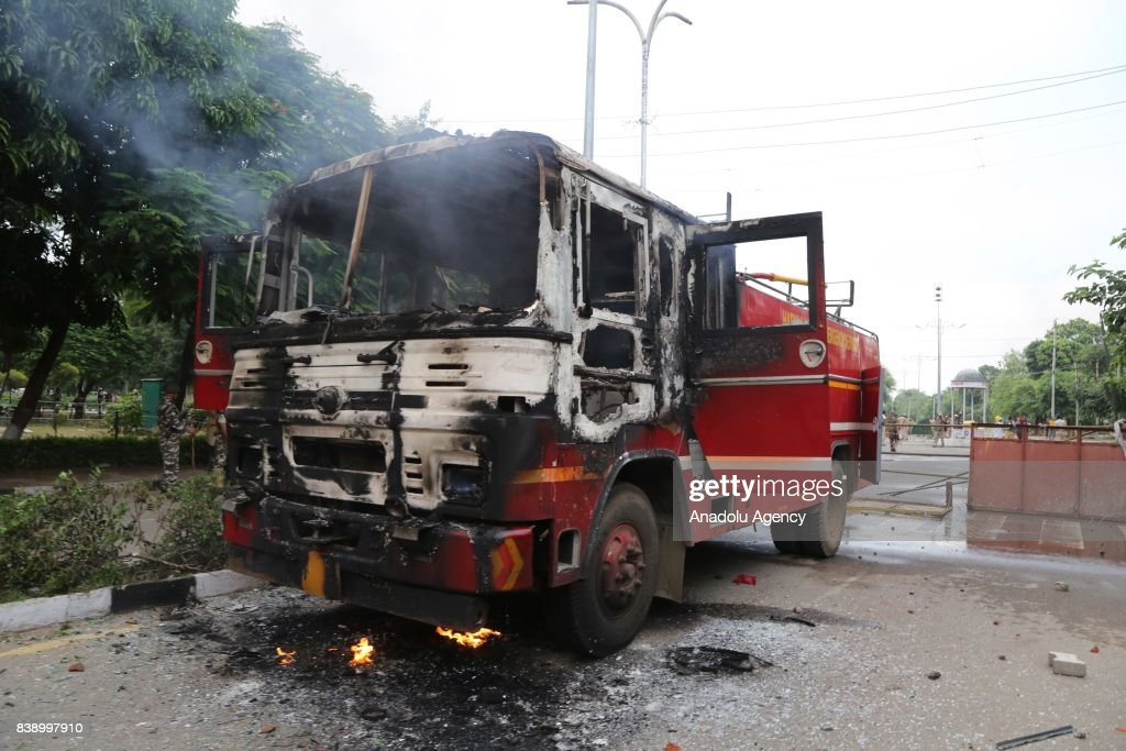 A destroyed vehicle is seen after Dera followers fire up the vehicles in Panchkula sector 4 after the Dera chief verdict at CBI court on August 25...