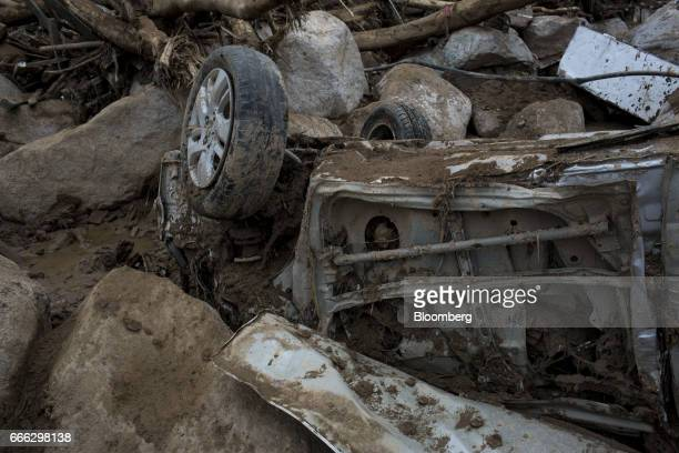 A destroyed vehicle sits under debris after a landslide in the San Miguel neighborhood of Mocoa Putumayo Colombia on Monday April 3 2017 Torrential...