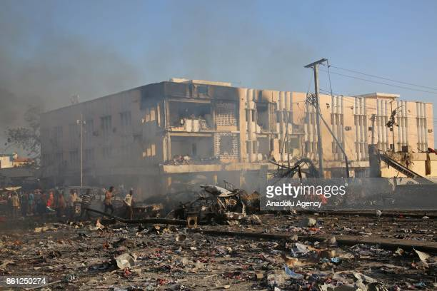 Destroyed vehicles are seen at the scene of a massive explosion in the capital Mogadishu Somalia on October 14 2017
