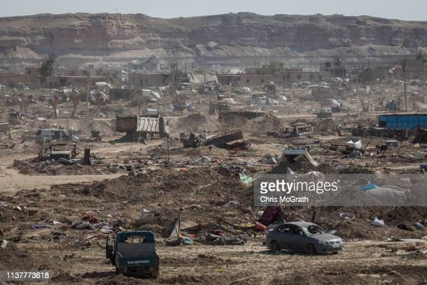 Destroyed vehicles are seen in the destroyed ISIL encampment on March 23 2019 in Baghouz Syria The Kurdishled and Americanbacked Syrian Defense...