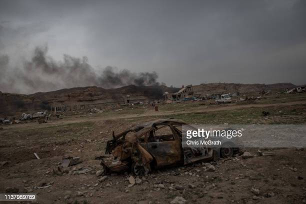 Destroyed vehicles are seen in the final ISIL encampment on March 24, 2019 in Baghouz, Syria. The Kurdish-led and American-backed Syrian Defense...