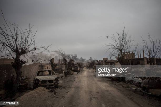 Destroyed vehicles are seen in the final ISIL encampment on March 24 2019 in Baghouz Syria The Kurdishled and Americanbacked Syrian Defense Forces...