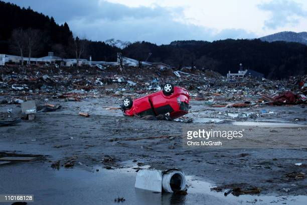 Destroyed vehicles lie near the rubble after the earthquake and tsunami devastated the area on March 16 2011 in Minamisanriku Japan The 90 magnitude...