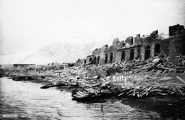 Destroyed warehouses on the waterfront after the eruption of the Mount Pelee volcano on May 10 1902 at St Pierre Martinique