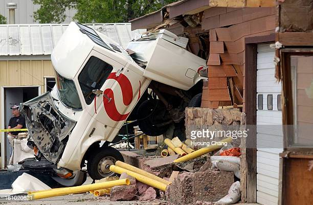 GRANBY CO JUNE 5 2004 Destroyed Xcel energy truck is stuck into the Mountain Parks Electric building as a result of Marvin Heemeyer's rampage with an...