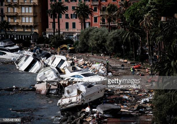 Destroyed yachts and boats lie in the harbour of Rapallo, near Genoa, on October 30 after a storm hit the region and destroyed a part of the dam the...