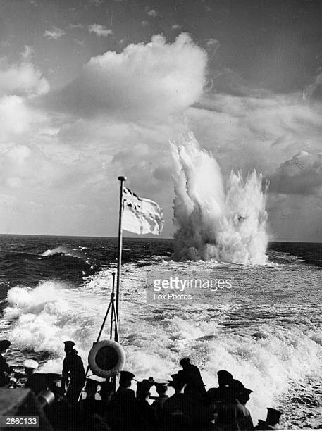 Destroyer escorts firing depth charges against submarine raiders during war in the Atlantic.