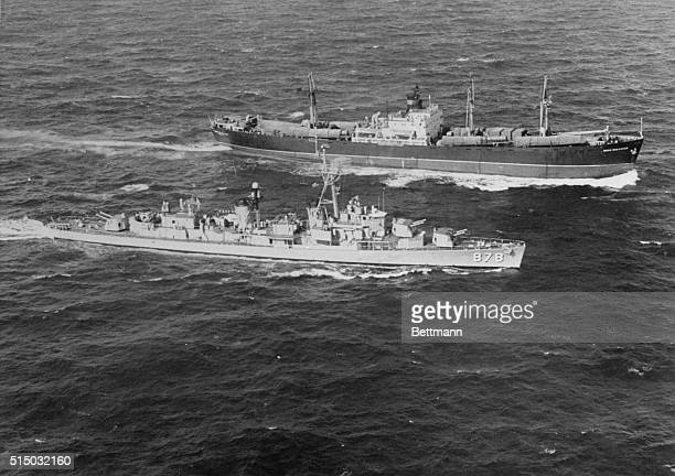 Destroyer Inspects Soviet Freighter. Off Coast of Cuba: The U.S.S. Vesole steams alongside the Soviet freighter Polzunov, outbound from Cuba, for an...