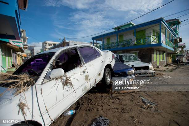 TOPSHOT Destruction and debris are seen in Roseau capital of the Caribbean island Dominica September 21 three days after passage of Hurricane Maria...